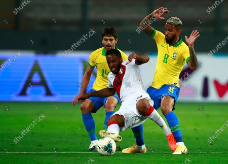 Stock Image of Peru's Jefferson Farfan, center, Brazil's Rodrigo Caio, left, and Brazil's Douglas Luiz fight for the ball during a qualifying soccer match for the FIFA World Cup Qatar 2022 at the National Stadium, in Lima, Peru, Tuesday, Oct.13, 2020