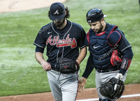 Atlanta Braves starting pitcher Ian Anderson (L) and Atlanta Braves catcher Travis d'Arnaud (R) walk to the dugout at the end of the fourth inning of the MLB National League Championship Series baseball game two between the Atlanta Braves and the Los Angeles Dodgers at Globe Life Field in Arlington, Texas, USA, 13 October 2020.