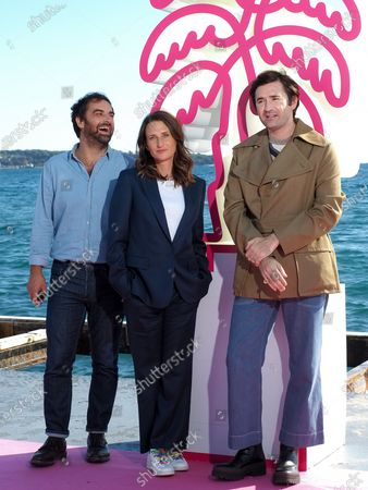 """Gregory Montel, Camille Cottin and Nicolas Maury attends the """"Dix Pour Cent"""" photocall at the 3rd Canneseries on October 13, 2020 in Cannes, France."""
