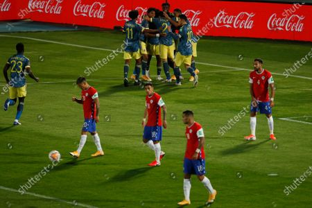 Players of Colombia celebrate the opening goal against Chile, scored by Jefferson Lerma, during a qualifying soccer match for the FIFA World Cup Qatar 2022 at the Nacional Julio Martinez Pradanos, stadium in Santiago, Chile