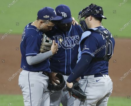 Tampa Bay Rays third baseman Joey Wendle (L) and Tampa Bay Rays catcher Mike Zunino (R) talk with Tampa Bay Rays relief pitcher Diego Castillo (C) during the ninth inning of the MLB American League Championship Series playoff baseball game three between the Tampa Bay Rays and the Houston Astros at Petco Park in San Diego, California, USA, 13 October 2020.