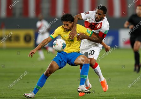 Stock Photo of Peru's Jefferson Farfan (R) vies for the ball with Marquinhos (L) of Brazil during the Qatar 2022 World Cup South American qualifiers match between Peru and Brazil at the National stadium in Lima, Peru, 13 October 2020.