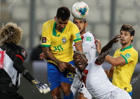 Stock Image of Luis Advincula (R) of Peru vies for the ball with Roberto Firmino of Brazil during the Qatar 2022 World Cup South American qualifiers match between Peru and Brazil at the National stadium in Lima, Peru, 13 October 2020.