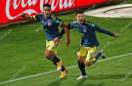 Radamel Falcao (L) of Colombia celebrates after scoring with James Rodriguez during the South American qualifier soccer match for the 2022 FIFA World Cup Qatar between Chile and Colombia, at the National stadium, in Santiago, Chile, 13 October 2020.