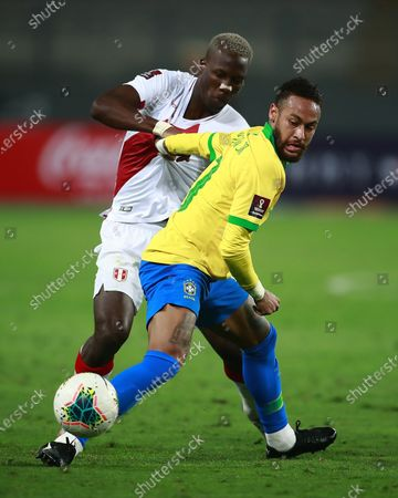 Stock Photo of Brazil's Neymar, right, and Peru's Luis Advincula fight for the ball during a qualifying soccer match for the FIFA World Cup Qatar 2022 at the National Stadium, in Lima, Peru, Tuesday, Oct.13, 2020