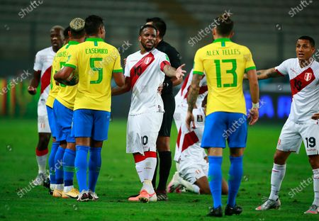 Peru's Jefferson Farfan, center, argues with Brazil's Alex Telles, 2nd right, during a qualifying soccer match for the FIFA World Cup Qatar 2022 at the National Stadium, in Lima, Peru, Tuesday, Oct.13, 2020