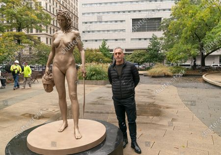 Artist Luciano Garbati stands next to Medusa With The Head of Perseus (MWTH) sculpture unveiled in Collect Pond Park in honor the 'Me Too' movement. Sculpture inverts the narrative of myth of Medusa, portraying her in a moment of somberly empowered self-defense. In myth Medusa is herself blamed and punished for the crime of which she was the victim. Godess Athena banishes and curses Medusa with a monstrous head of snakes and a gaze which turns men to stone. She was beheaded by the epic hero Perseus. Sculpture has been installed directly in front of New York Criminal Court where Harvey Weinstein trial took place.