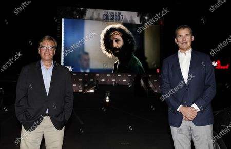 """Aaron Sorkin, left, writer/director of """"The Trial of the Chicago 7,"""" poses with Scott Stuber, head of original films at Netflix, at the drive-in premiere of the film, at the Rose Bowl in Pasadena, Calif"""