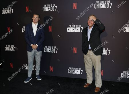 """Stock Picture of Aaron Sorkin, right, writer/director of """"The Trial of the Chicago 7,"""" poses with Scott Stuber, head of original films at Netflix, at the drive-in premiere of the film, at the Rose Bowl in Pasadena, Calif"""