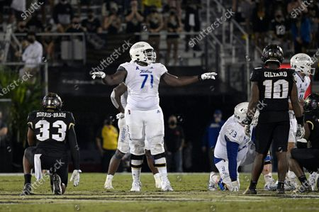Tulsa offensive tackle Chris Paul (71) sets up for a play against Central Florida defensive lineman Tre'mon Morris-Brash (33) and linebacker Eriq Gilyard (10) during the second half of an NCAA college football game, in Orlando, Fla
