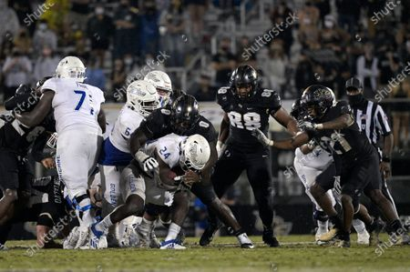 Tulsa running back Corey Taylor II (24) is tackled at the line of scrimmage by Central Florida defensive lineman Kenny Turnier (0) on a running play during the second half of an NCAA college football game, in Orlando, Fla