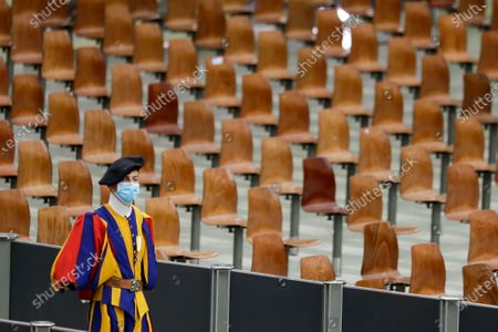 Vatican Swiss guard wears a face mask to prevent the spread of COVID-19 as he stands on attention during Pope Francis' weekly general audience in the Pope Paul VI hall at the Vatican