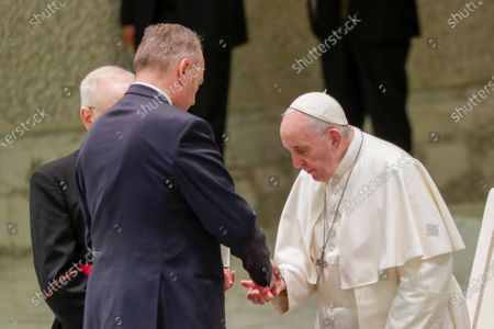 Pope Francis gets his hands sanitized at the start of his weekly general audience in the Pope Paul VI hall at the Vatican