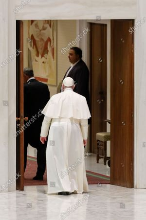 Pope Francis leaves at the end of his weekly general audience in the Pope Paul VI hall at the Vatican