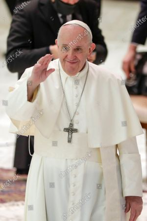 Pope Francis arrives for his weekly general audience in the Pope Paul VI hall at the Vatican