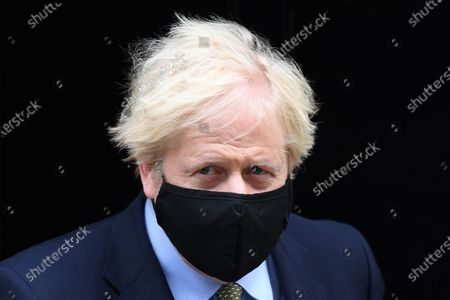 Boris Johnson leaves No.10 Downing Street to attend PMQs at the House of Commons.