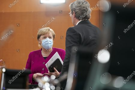German Chancellor Angela Merkel (L) and Transport Minister Andreas Scheuer (R) attend during the weekly German Cabinet meeting in Berlin, Germany, 14 October 2020.