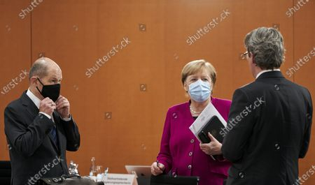(L-R) German Finance Minister Olaf Scholz, Chancellor Angela Merkel, and Transport Minister Andreas Scheuer attend during the weekly German Cabinet meeting in Berlin, Germany, 14 October 2020.