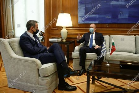 Greek Prime Minister Kyriakos Mitsotakis (L) talks with Bulgarian President Rumen Radev (R) during their meeting in Athens, Greece, 14 October 2020. Bulgarian President Rumen Radev is on an official visit in Athens.