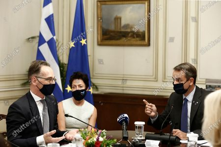 Greek Prime Minister Kyriakos Mitsotakis welcomes Bulgarian President Rumen Radev (R) during their meeting in Athens, Greece, 14 October 2020. Bulgarian President Rumen Radev is on an official visit in Athens.