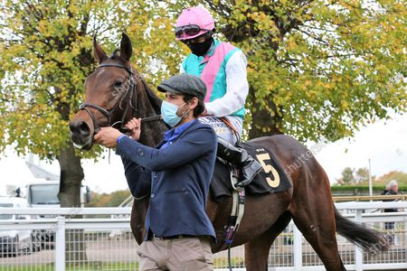 NOON STAR ridden by Ryan Moore and trained by Sir Michael Stoute enter the Winners Enclosure after winning The EBF Maiden Fillies Stakes (Plus 10/GBB Race) over 1m at Nottingham Racecourse, Nottingham