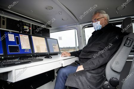 Bavarian Minister of the Interior, Joachim Herrmann, poses in a  weighing system car during a visit of a police checkpoint at the motorway A99 in Grasbrunn near Munich, Bavaria, Germany, 14 October 2020. As part of the action of ROADPOL, the European network of traffic police, police checks of trucks and buses took place throughout Europe. The aim is to further reduce the number of heavy traffic accidents.