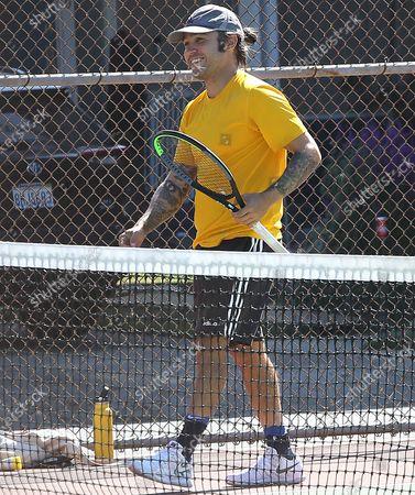 Pete Wentz playing tennis