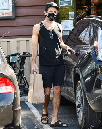 Zachary Quinto is seen getting coffee