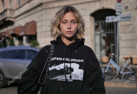 Model posing for photographers in the street after Philisophy by Lorenzo Serafini at Milano Fashion Week 2020/2021 Fall/Winter collections.