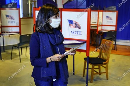 Sara Gideon, Democratic candidate for U.S. Senate, prepares to hand in her absentee ballot at Town Hall, in Freeport, Maine. Gideon, the speaker of the Maine House, is challenging incumbent Republican Sen. Susan Collins