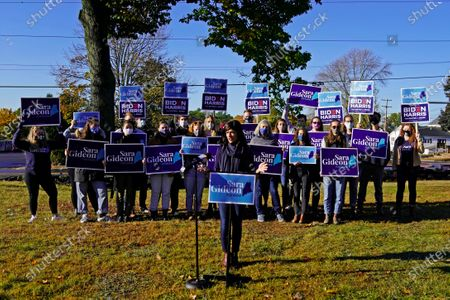 Sara Gideon, Democratic candidate for U.S. Senate, speaks in front of supporters after casting her absentee ballot, in Freeport, Maine. Gideon, the speaker of the Maine House, is challenging incumbent Republican Sen. Susan Collins
