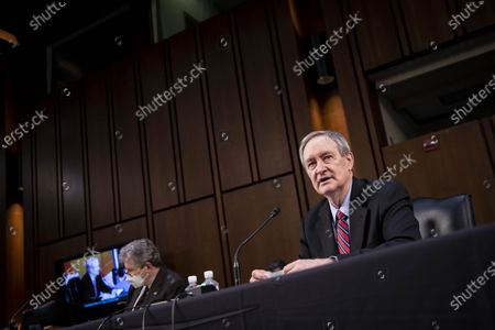 Senator Mike Crapo, a Republican from Idaho, questions Amy Coney Barrett, U.S. President Donald Trump's nominee for associate justice of the U.S. Supreme Court, during a Senate Judiciary Committee confirmation hearing on Capitol Hill in Washington, D.C., U.S.,. Photographer: Sarah Silbiger/Bloomberg