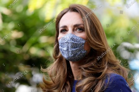 Stock Photo of Britain's Kate, the Duchess of Cambridge wearing a face mask to protect against coronavirus, arrives to visit the Institute of Reproductive and Development Biology, at Imperial College in London, . The Duchess of Cambridge visited the London research centre to hear about the work that national charity Tommy's are doing to reduce rates of miscarriage, stillbirth and premature birth