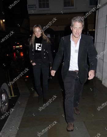 Stock Picture of Hugh Grant and wife Anna Elisabet Eberstein at Loulou's