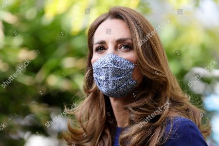 Catherine Duchess of Cambridge wearing a face mask to protect against coronavirus, arrives to visit the Institute of Reproductive and Development Biology, at Imperial College in London, Wednesday, Oct. 14, 2020. The Duchess visited the London research centre to hear about the work that national charity Tommy's are doing to reduce rates of miscarriage, stillbirth and premature birth.
