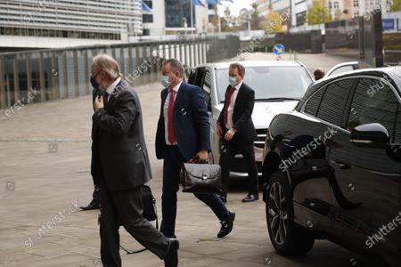 Britain's chief negotiator David Frost, center, and Britain's Permanent Representative to the EU Tim Barrow, left, arrive at EU headquarters for Brexit talks with EU chief negotiator Michel Barnier in Brussels
