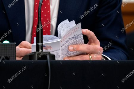 United States Senator Josh Hawley (Republican of Missouri), reads from a copy of the U.S. Constitution during a Senate Judiciary Committee confirmation hearing in Washington, D.C., U.S.,. Senate Democrats enter a second day of questioning Barrett having made few inroads in their fight to keep her off the Supreme Court and elicited few clues about how she would rule on key cases.