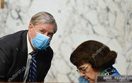 Senator Lindsey Graham (R-NC) speaks with Dianne Feinstein (D-CA) during the third day of Senate Judiciary Committee confirmation hearings for Judge Barrett on Capitol Hill in Washington, DC, USA, 14 October 2020. The hearings are expected to last four days.