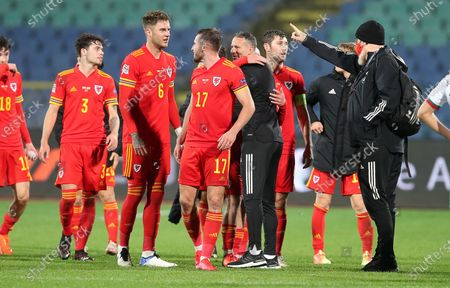 Wales Manager Ryan Giggs and players celebrate at full time after their victory.