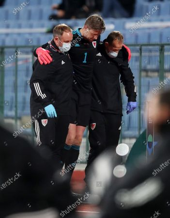 Wayne Hennessey of Wales is taken off the field injured.