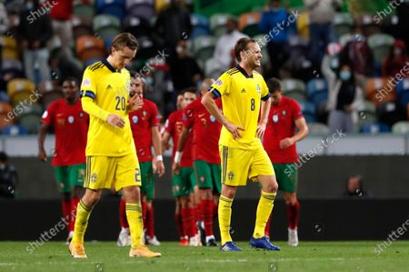 Sweden's Kristoffer Olsson, left, and Sweden's Albin Ekdal react after Portugal's Diogo Jota celebrates scored his side's third goal during the UEFA Nations League soccer match between Portugal and Sweden at the Jose Alvalade stadium in Lisbon, Portugal