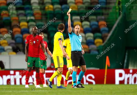 Referee Srdan Jovanovic gives yellow card to Sweden's Albin Ekdal during the UEFA Nations League soccer match between Portugal and Sweden at the Jose Alvalade stadium in Lisbon, Portugal