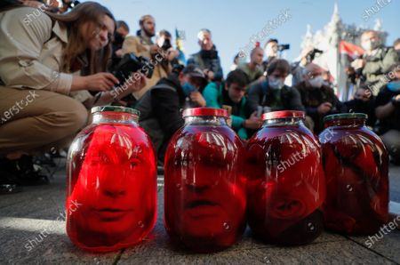 Activists of different nationalists parties display symbolic sealed jars with portraits of Russian President Putin and pro-Russian politicians who came to power in Ukraine during President Zelensky, during a march with the slogan 'The battle to collaborators!' in Kiev, Ukraine, 14 October 2020.  Ukrainians mark the 'Day of Defender of Motherland' and the 78th anniversary of founding the Ukrainian Insurgent Army (UPA), which fought for Ukrainian independence against the Soviet Red Army and the Nazis during the Second World War.