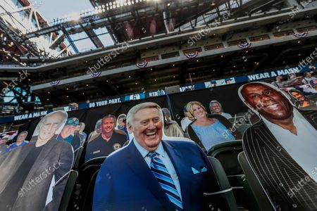 Arlington, Texas, Tuesday, October 13, 2020. Vin Scully and Magic Johnson in seated behind the Dodgers dugout in game two of the NLCS at Globe Life Field. (Robert Gauthier/ Los Angeles Times)
