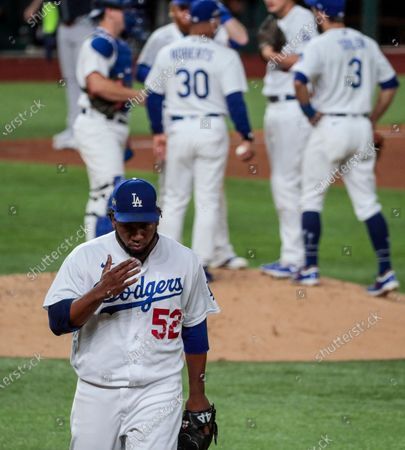 Arlington, Texas, Tuesday, October 13, 2020. Los Angeles Dodgers relief pitcher Pedro Baez (52) leaves the game after a poor performance in the fifth inning against the Braves in game two of the NLCS at Globe Life Field. (Robert Gauthier/ Los Angeles Times)