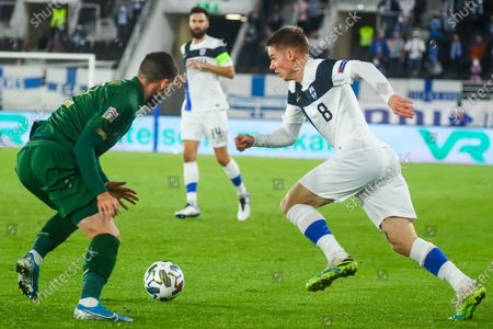 Stock Photo of Matt Doherty (L) of Republic of Ireland in action against Robert Taylor  (R) of Finland  during the UEFA Nations League soccer match between Finland and Republic of Ireland at Helsinki Olympic Stadium, Helsinki, Finland, 14 October 2020.