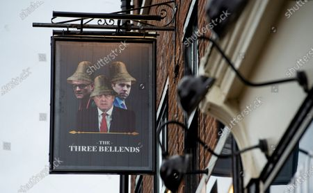 An image of Britains's Prime Minister Boris Johnson, Britains Health Secretary Matt Hancock and Number 10 Special advisor Dominic Cummings, is pictured on a sign outside the re-branded The James Anderson Pub, which has been renamed as 'The Three Bellends', in protest against the government's handling of the coronavirus pandemic , New Brighton, Wirral, Britain, 14 October 2020. New Local lockdown measures came into force in the Liverpool City Region on 14 October 2020.