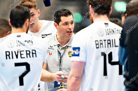 Stock Image of Nantes' coach Alberto Rodriguez Entrerrios (C) gives instructions to his players during the EHF Champions League handball match between Aalborg Handbold and HBC Nantes at Jutlander Bank Arena in Aalborg, Denmark, 14 October 2020.