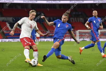 Stock Photo of Daniel Wass of Denmark (L) and Kalvin Phillips of England (R) in action during the UEFA Nations League match between England and Denmark in London, Britain, 14 October 2020.