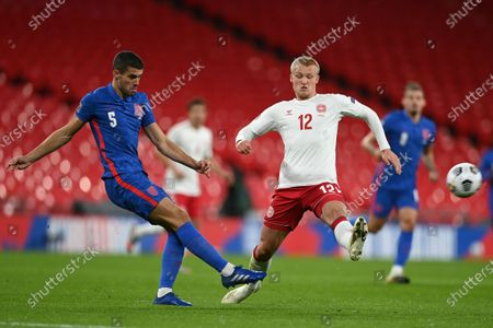 Conor Coady of England (L) and Kasper Dolberg of Denmark (R) in action during the UEFA Nations League match between England and Denmark in London, Britain, 14 October 2020.